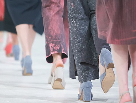 Shot of models from the waist down walking on a runway