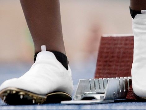 Runner's feet at a starting line. Photo Credit:gettyimages/Robin Skjoldborg