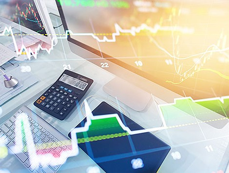 Calculator on a desk with overlays of stocks and data analysis charts
