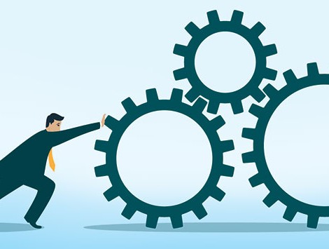 Illustration of a businessman pushing gears